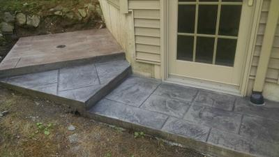 Stamped concrete for outdoor shower and entry door